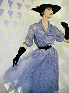 Model in sheer polka-dot organdy dress with sailor-tie, black leather belt holds the fullness of the skirt, by Christian Dior, photo by Pottier, 1954