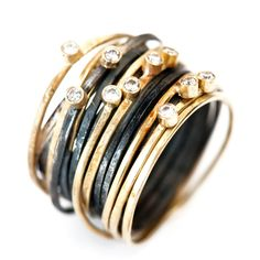 Disa Allsopp Jewellery. 18ct gold and oxidised silver spaghetti rings (8 coils each) with 10 0.03ct diamonds
