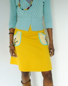 Skirt with detailed trimmed pockets and cute blue textured cardigan.
