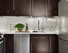 dark cabinets, light counters, light subway tile and under cabinet lighting.