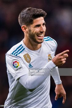 Marco Asensio Willemsen of Real Madrid celebrates after scoring his goal during the La Liga match between Real Madrid and UD Las Palmas at Estadio Santiago Bernabeu on November 05 2017 in Madrid, Spain. Real Madrid Kit, Real Madrid Players, Cristiano Ronaldo Portugal, Cristiano Ronaldo Lionel Messi, Best Hotels In Madrid, Real Madrid Manchester United, Equipe Real Madrid, Real Madrid Wallpapers, Barcelona Soccer