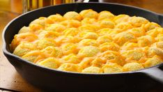 A spicy jalapeño popper monkey bread filled with cream cheese and topped with cheese.