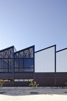 ATELIER ARS° : Completed in 2014 in Zapopan, Mexico Images by Onnis Luque We wanted to propose a building that was able to communicate its industrial condition through the architectural elements So we recalled a couple of - Factory Architecture, Facade Architecture, Industrial Architecture, Futuristic Architecture, Building Exterior, Building Facade, Industrial Sheds, Steel Structure Buildings, Warehouse Design