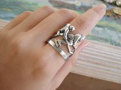 The game - matte silver plated brass two Hockey Players rich detailed ring. $14.00, via Etsy.