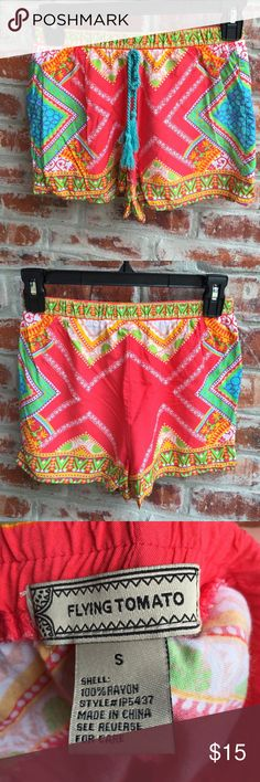 "Flying Tomato Tassel Shorts Size Small Never worn Flying Tomato brand tassel shorts in size small. These shorts run a little small, please check measurements. Waist will stretch to 30""+ Hips up to 36"" Inseam 2"". These shorts are super cute! Flying Tomato Shorts"