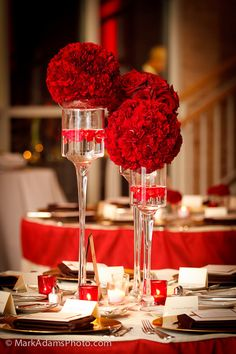 red centerpieces pretty cute and elegant! Wonder if I can find theses candle sticks at goodwill!