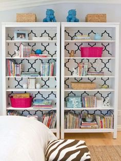 Double up the impact - and your display or storage space - with side-by-side bookcases. Something as simple as adding a geometric pattern wallpaper to the back of the bookcases can make them a feature in a room.