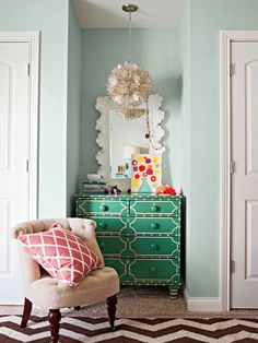 Kelly-ish green dresser in a pale turquoise room