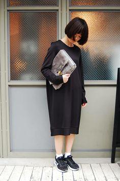 A sack-like sweatshirt dress and sneakers.