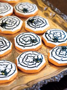 Cobweb #Cookies.  To conjure up a devilish-looking dessert, frost slice-and-bake sugar cookies with white royal icing. Then, starting at the cookie's center, pipe circles of black icing; create cobwebs by alternately dragging a toothpick from the center to the edge, and from the edge to the center.  Perfect dish for #Halloween.