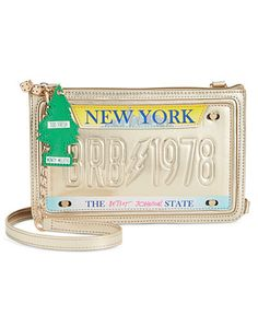 """Headed out? From road trips to rock shows, grab the bag that's going fabulous places. License plate crossbody clutch by Betsey Johnson. 