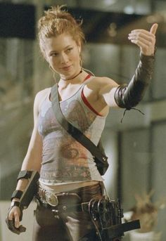 Eh....she reminds me a little bit of Dixie in some ways. The pants and arm guards especially. And the hair style.
