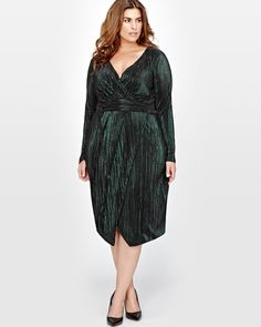 Opt for this sophisticated plus size faux wrap dress by Rachel Roy for an evening out.<br /><br />Fit & cut<br />- Long sleeves<br />- V-neckline<br />- Fitted<br /><br />Design details<br />- Shiny knit<br />- Faux wrap effect