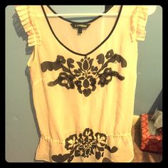 Express top Beautiful express top size small black and cream with beadwork on the bodice cinched waist one small snag but not apparent when on Express Tops Blouses