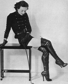 1968  Here's a gallery of vintage photographs of women dressed in dominatrix gear. Not all of the women pictured were necessarily dominatrixes by trade, some were no doubt fetish models for BDSM-style magazines back in the day. I'm digging the costumes, hairstyles and… the boots. Just look at those kinky boots!   I tried to keep this as safe for work as possible. But, you know, it might be a tad NSFW-ish because of the topic.                  1930s