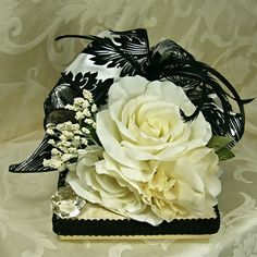Black and white gift box magnificently decorated with silk flowers, feathers, ribbons and jewels!