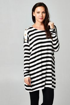 Striped print is striking and flaunts clean lines. Button detailing on one shoulder. Fabulous flow. Causal top.