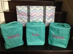 """Thirty-One Organizational idea: The three """"single organizers"""" fit in the """"large utility tote"""", customer keeps it in the truck filled with spare clothes/supplies for each child. Great idea! Also great for a weekend away, packing for each child. Thirty-One's Large Utility Tote in Party Punch print, with 3 Single Organizers in Turquoise Cross Pop (Hot pink, Style 19 embroidery) by vera"""