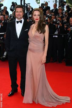 Angelina Jolie and Brad Pitt attend the 'Inglourious Basterds' Premiere at the 62nd Annual Cannes Film Festival, May 2009. Angelina wears a Versace dress