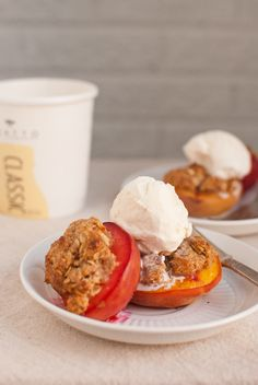 Individual Peach Crisps by cookieandkate: Simply made by filling peach halves with yogurt/oat topping and baking in the oven! #Peach_Crisps #cookieandkate