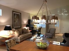 """A great space comes to light! #TIP: Hang a magnificent chandelier in a casual-styled room to ramp up its ambiance and """"wow"""" factor."""