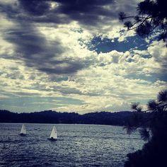 cloudy sky, sailboats on the lake