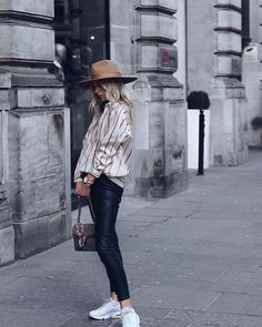 While you may associate fedoras with colder weather, don't stick them in the back of your closet just yet. The chic topper is the easiest way to stay shaded