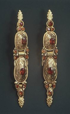 "18th century, Spanish pair of earrings. Made of gold and   jacinths , they are 4 1/2"" long."