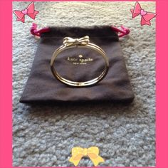 "Kate Spade Double Bangle Bow Bracelet Gold✨ Beautiful Gold Tone double bangle Bow bracelet  12 Karat Gold Plated . ✨✨As gorgeous as the day I got it!!!!.  Inner diameter is 2 1/2"", comes in original Duster bag. Measured around bracelet and it is 7 3/4"". Hinged closure is great, no need for help!!!! kate spade Jewelry Bracelets"