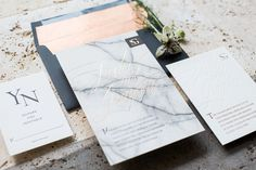 Marble wedding details like marble invitations, marble wedding cakes and marble place cards make for a modern, chic wedding design.
