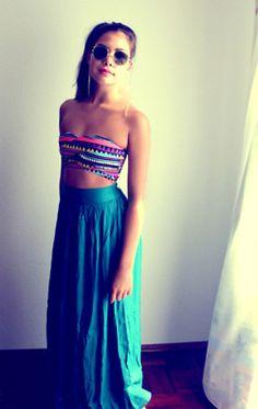 bandeau tops and high waisted skirts.