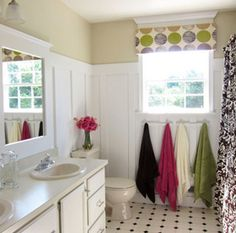White molding downstairs bath plus flooring thats tile but looks like wood floors = ADORBS!