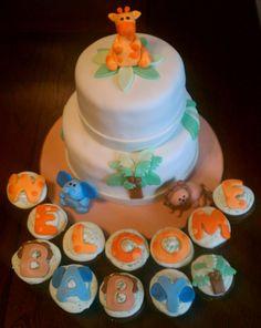 Jungle Themed Baby Shower Cake and Cupcakes - Cake:  French Vanilla , Lemon Filling, Vanilla Buttercream, Marshmallow Fondant Decorations  Cupcakes:  Chocolate Hazelnut, Vanilla Hazelnut Buttercream, Marshmallow Fondant Decorations