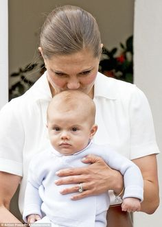 The Crown Princess kisses her baby son Oscar who was making his first appearance at an off...