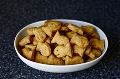 Whole Wheat Goldfish Crackers! I may try this. You just put the few ingredients into a food processor. blend. roll it out. Cut out the shapes (I would go simpler than the goldfish, although they are cute) and bake