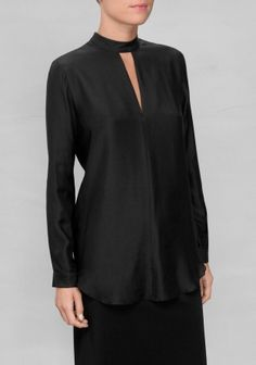 & OTHER STORIES Sensual meets demure in this stunning silk-blend blouse topped with a stand-up collar and a flirtatious cut-out detail below.