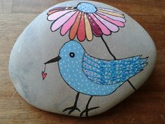 Bird and flower painted on a stone