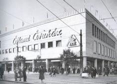1950-es, 1960-as évek. Újpest, az Árpád út és a Bajcsy-Zsilinszky út kereszteződése, az Állami áruház. 1952-ben épült Rákos Pál tervei alapján.Elmúlt kb.:60 év, de az épület szinte semmit sem változott. Legfeljebb a felirat.AzÁllami áruház híres még a róla készült filmről is. Függetlenül a politikától ez egy jópofa film volt.