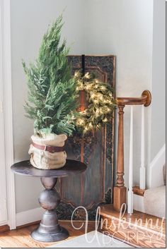 Love the belt on the burlap around the tree! by Unskinny Boppy