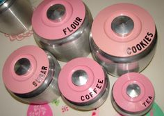 """Kromex Canisters 1950s Aluminum canisters in colors of.... Pink, turquoise, black and yellow. """"Kromex Spun Aluminum Canisters"""". Outside of canisters have a brush finish. Top is hard plastic with an aluminum knob."""