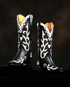 Have been dying for a pair of cowboy boots....these may be it - Black Venus Calf Boot.