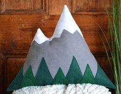 This mountain pillow with felt fabric trees at the base is perfect for adding a touch of nature in your modern rustic decor, to complete a woodland