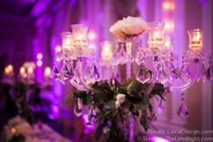 Spray Roses on top of crystal candelabras for head table centerpieces