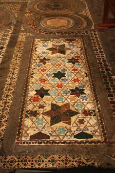 The Cosmati Pavement 1268, after restoration 2010: Wenlock tomb lid containing opaque and translucent glass