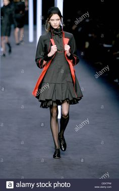 arl Lagerfeld Paris Ready to Wear Autumn Winter Female wearing a grey mini dress a dropped waist and box pleats a black bow Fall Winter, Autumn, Box Pleats, Karl Lagerfeld, Ready To Wear, Ballet Skirt, Bows, Stock Photos, Paris