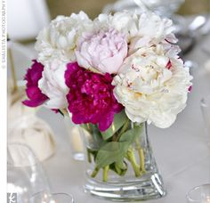 Chic pink and white peony centerpieces adorned the reception tables.