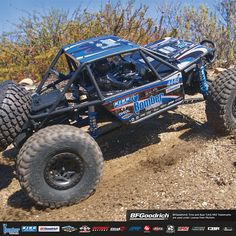 Axial® RR10 Bomber 4WD RTR. Scale details include a Lexan® interior with molded driver figure, in addition to licensed, machined aluminum 103 mm King shocks, high-traction BFGoodrich® Baja™ T/A® KR2 tires and 12 mm hex, 2.2 Walker Evans wheels.