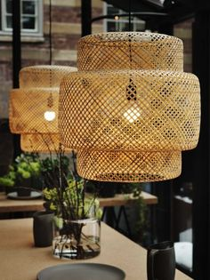 Pendant Lamp Handmade lamps feature criss-crossing lacquered bamboo strips that lend interiors a rough-hewn, naturalistic quality. $60