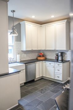 I like everything about this look. Maybe a color for backsplash and a darker floor.