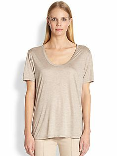 """The Row Classic Tee $250  Silky, fluid knit jersey, in a scoopneck style for a perfect layering piece.  Scoopneck Short sleeves About 26"""" from shoulder to hem Viscose Dry clean Made in USA of Italian fabric"""